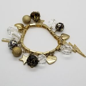 Betsey Johnson gold tone charm bracelet
